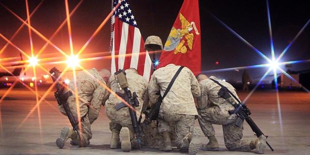 Soldiers kneeling